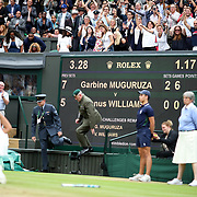 LONDON, ENGLAND - JULY 15:  Garbine Muguruza of Spain celebrates victory in the Ladies Singles final cheered by coach Conchita Martinez and family members in the  family box during the Ladies Singles final against Venus Williams of The United States in the Wimbledon Lawn Tennis Championships at the All England Lawn Tennis and Croquet Club at Wimbledon on July 15, 2017 in London, England. (Photo by Tim Clayton/Corbis via Getty Images)