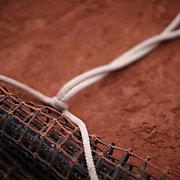 2017 French Open Tennis Tournament - Day Seven.  Netting for cleaning the clay surface rolled up beside the court at the 2017 French Open Tennis Tournament at Roland Garros on June 3rd, 2017 in Paris, France.  (Photo by Tim Clayton/Corbis via Getty Images)