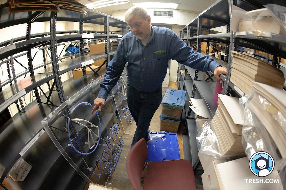 Deacon Maccubbin, owner of Lambda Rising, gives documents to Rainbow History Project, Sunday, January 24, 2010.