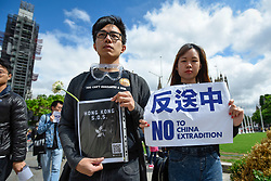 © Licensed to London News Pictures. 16/06/2019. LONDON, UK.  Hong Kong people living in the UK stage a protest in Parliament Square calling for the resignation of Hong Kong Chief Executive Carrie Lam and an end to police violence against the people of Hong Kong.  In Hong Kong itself, protesters dressed in black are demanding a full retraction of the China extradition law.  Carrie Lam, announced an indefinite halt to the proposed bill, which would allow residents and visitors to be sent for trial in China's Communist-controlled court system.  Photo credit: Stephen Chung/LNP