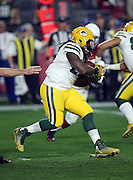 Green Bay Packers running back Eddie Lacy (27) runs the ball in the first quarter during the NFL NFC Divisional round playoff football game against the Arizona Cardinals on Saturday, Jan. 16, 2016 in Glendale, Ariz. The Cardinals won the game in overtime 26-20. (©Paul Anthony Spinelli)