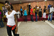Nana Yaa Adadewa Addo (left), 24, practices her catwalk while other models wait for their turn during a rehearsal in Ghana's capital Accra on Thursday May 21, 2009. Nana Yaa is one of several Ghanaian girls who auditioned for the upcoming television show West Africa's Next Top Model, the latest incarnation of Tyra Banks' America's Next Top Model.