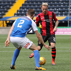 Danny Handling passes by Stephen O'Donnell during the Kilmarnock v Dumbarton Betfred Cup Group E  29nd July 2017 <br /> <br /> <br /> <br /> <br /> (c) Andy Scott | SportPix.org.uk