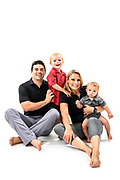 Fitness trainers Peter and Shana Verstegen are pictured with their sons, Greyson and Clark, in a studio portrait in Madison, Wis., on July. 21, 2019. (Photo by Jeff Miller, www.jeffmillerphotography.com)