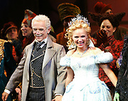 "NEW YORK - OCTOBER 30:  Actor Joel Grey and actress Kristin Chenoweth perform on stage during the opening night performance of the Broadway musical ""Wicked"" at The Gershwin Theatre October 30, 2003 in New York City.  (Photo by Matthew Peyton)"