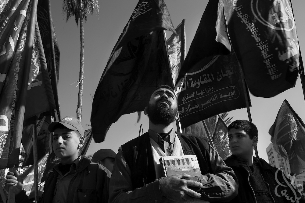 """Palestinian take part in a """"Victory"""" parade thrown by militant Palestinian political group HAMAS January 20, 2009 in Gaza City. Several thousand marchers celebrated what HAMAS called the defeat of Israel during the recent 21 day offensive by Israeli forces against HAMAS fighters. During the operation more than 1500 Palestinians were killed and more than 4000 homes destroyed in the narrow Gaza Strip..."""