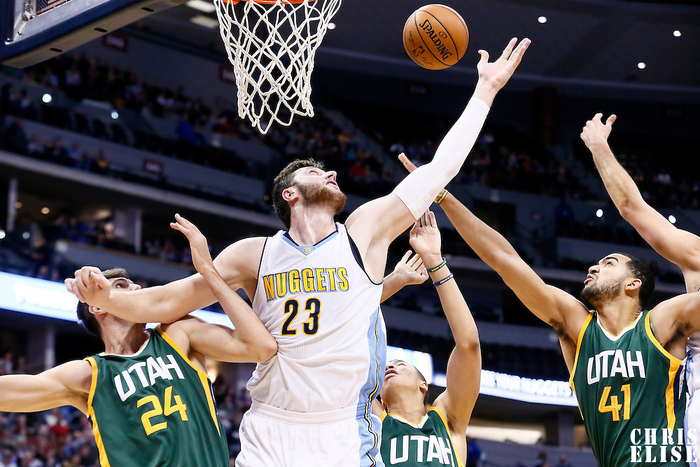 20 November 2016: Denver Nuggets center Jusuf Nurkic (23) vies for the rebound with Utah Jazz center Jeff Withey (24), Utah Jazz forward Trey Lyles (41) and Utah Jazz guard Dante Exum (11) during the Denver Nuggets 105-91 victory over the Utah Jazz, at the Pepsi Center, Denver, Colorado, USA.