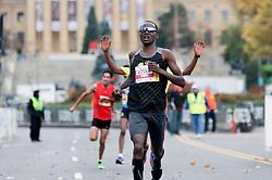 Teklu Deneke, of USA, and Gisele Olalde Granados, of MEX, win the November 22, 2015 Philadelphia Marathon on the Ben Franklin parkway in Center City Philadelphia, PA. A total of 25.000 runners compete in the half and full marathon. (Photo by Bastiaan Slabbers)<br /> <br /> License file: http://www.istockphoto.com/photo/finish-of-philadelphia-half-marathon-79497699