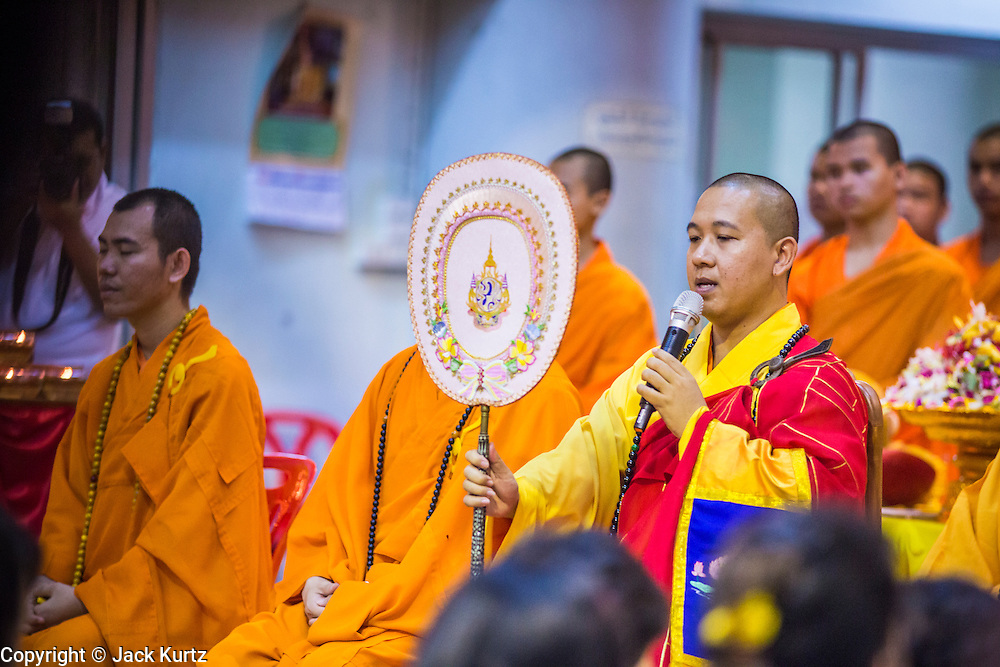 23 OCTOBER 2012 - HAT YAI, SONGKHLA, THAILAND: Monks lead a special chanting service to mark the end of the Vegetarian Festival at Wat Ta Won Vararum, a Chinese Buddhist temple in Hat Yai. The Vegetarian Festival is celebrated in Thai-Chinese communities throughout Thailand. It is the Thai Buddhist version of the The Nine Emperor Gods Festival, a nine-day Taoist celebration celebrated in the 9th lunar month of the Chinese calendar. For nine days, those who are participating in the festival dress all in white and abstain from eating meat, poultry, seafood, and dairy products. Vendors and proprietors of restaurants indicate that vegetarian food is for sale at their establishments by putting a yellow flag out with Thai characters for meatless written on it in red.   PHOTO BY JACK KURTZ