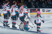 KELOWNA, CANADA - JANUARY 18: The Pepsi Player lines up with Michael Herringer #30, Cal Foote #25 and Gordie Ballhorn #4 of the Kelowna Rockets against the Moose Jaw Warriors on January 18, 2017 at Prospera Place in Kelowna, British Columbia, Canada.  (Photo by Marissa Baecker/Shoot the Breeze)  *** Local Caption ***