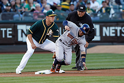 OAKLAND, CA - JULY 19:  Jose Altuve #27 of the Houston Astros slides into third base ahead of a tag from Ryon Healy #48 of the Oakland Athletics during the first inning at the Oakland Coliseum on July 19, 2016 in Oakland, California. (Photo by Jason O. Watson/Getty Images) *** Local Caption *** Jose Altuve; Ryon Healy