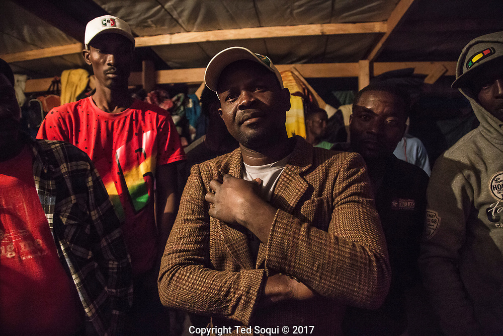 Haitian immigrants inside a shelter for deportees located near the Zona Rosa. Many of the Haitian refugees sleep on wooden pallets covered with donated blankets, and wear donated clothing.<br /> Haitian immigrants.<br /> Tijuana, Mexico.