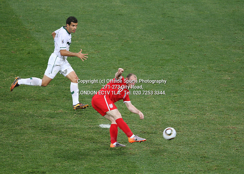 23/06/2010 World Cup. Slovenia v England.<br /> Wayne Rooney shoots but his shot hits the post.<br /> Photo: Mark Leech.