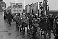 Striking BSC steel workers  and supporters marching in protest at the companies pay offer during the 13 week National strike . Sheffield 1980-01-21