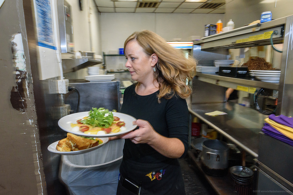 Server Rosalie Guthrie expedites an order. Lunchtime in the kitchen at Lilly's Monday, Aug. 15, 2016 with Chef/Owner Kathy Cary and staff. (Photo by Brian Bohannon)