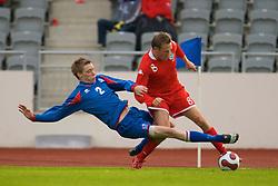 REYKJAVIK, ICELAND - Wednesday, May 28, 2008: Wales' Craig Bellamy and Iceland's Birkir Mar Saevarsson during the international friendly match at the Laugardalsvollur Stadium. (Photo by David Rawcliffe/Propaganda)
