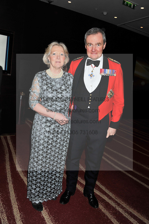 GENERAL SIR NICHOLAS HOUGHTON Vice Chief of the Defence Staff and LADY HOUGHTON at the Soldiering On Awards 2013 held at the Park Plaza Hotel, Westminster Bridge, London SE1 on 23rd March 2013.