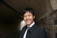 Portrait of handsome mid adult businessman smiling in a tunnel