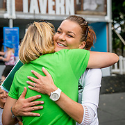 August 21, 2016, New Haven, Connecticut: <br /> Agnieszka Radwanska of Poland hugs Tournament Director Anne Worcester during WTA All-Access Hour on Day 3 of the 2016 Connecticut Open at the Yale University Tennis Center on Sunday, August  21, 2016 in New Haven, Connecticut. <br /> (Photo by Billie Weiss/Connecticut Open)