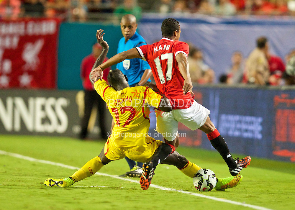 MIAMI, USA - Monday, August 4, 2014: Liverpool's Mamadou Sakho tackles Manchester United's Nani during the International Champions Cup Final match at the SunLife Stadium on day fifteen of the club's USA Tour. (Pic by David Rawcliffe/Propaganda)