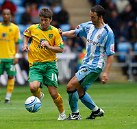 Photo: Richard Lane/Richard Lane Photography. Coventry City v Norwich City. Coca-Cola Championship. 09/08/2008. Coventry's Guillaume Beuzelin challenges  Norwich's Wes Hoolahan (lt).