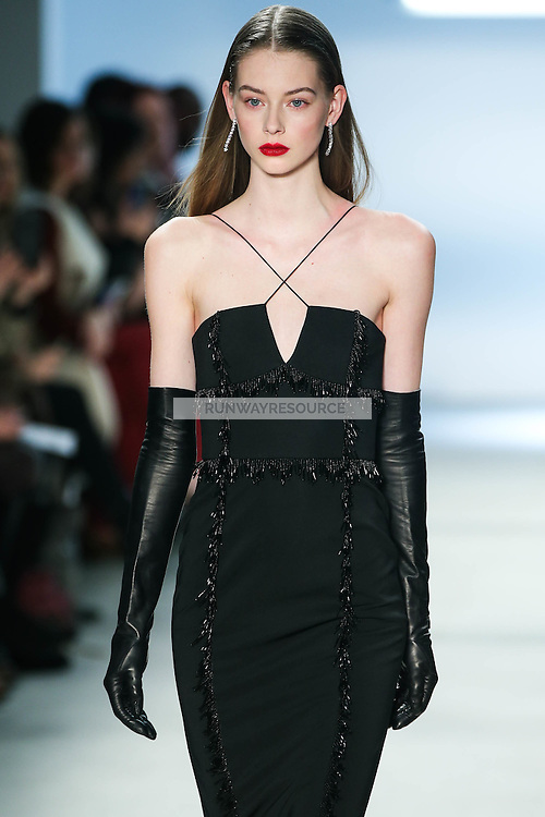 Lauren de Graaf walks the runway wearing Cushnie et Ochs Fall 2016, hair by Antonio Corral Calero for Moroccanoil, makeup by Val Garland, photographed by Thomas Concordia during New York Fashion Week on February 12, 2016