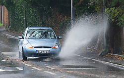 © Licensed to London News Pictures. 01/11/2018. St Mary Cray, UK.Heavy rain making for a wet weather morning in the South East. Water spray from a car. Photo credit: Grant Falvey/LNP