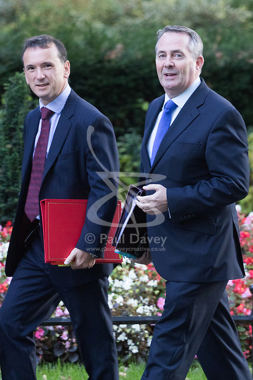 Downing Street, London, October 11th 2016. Government ministers arrive for the first post-conference cabinet meeting. PICTURED: Welsh Secretary Alun Cairns (l) and International Trade Secretary Liam Fox