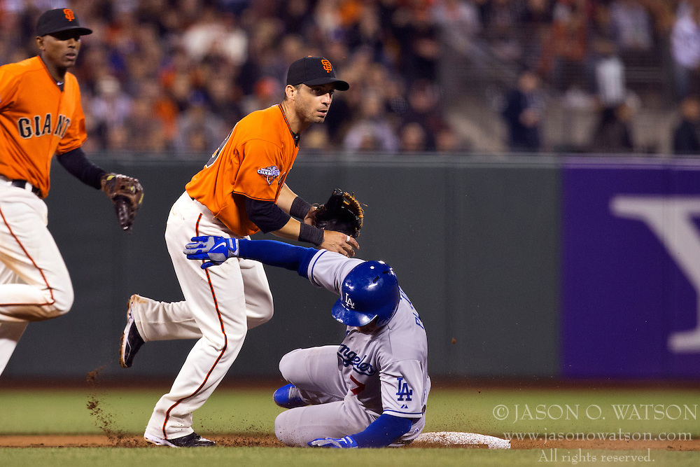 SAN FRANCISCO, CA - MAY 03:  Marco Scutaro #19 of the San Francisco Giants completes a double play over Nick Punto #7 of the Los Angeles Dodgers during the fifth inning at AT&T Park on May 3, 2013 in San Francisco, California. (Photo by Jason O. Watson/Getty Images) *** Local Caption *** Marco Scutaro; Nick Punto