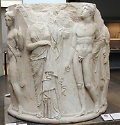 Marble column from the Temple of Artemis at Ephesos in Turkey. Greek, circa 340-320 BC One of the Seven Wonders of the World. Hermes, who gazes upwards with his kerykeion (winged staff) in his right hand and petasos (wide-brimmed sun hat) hanging behind his head.The woman standing in front of him, whom he appears to guide,
