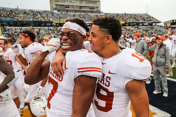 Nov 18, 2017; Morgantown, WV, USA; Texas Longhorns defensive back Antwuan Davis (7) and Texas Longhorns defensive back Brandon Jones (19) celebrate after beating the West Virginia Mountaineers at Milan Puskar Stadium. Mandatory Credit: Ben Queen-USA TODAY Sports