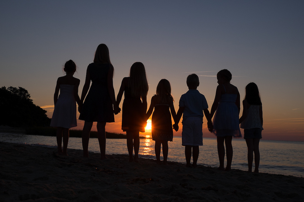 A silhouette portrait of children at sunset in Brewster, Massachusetts by portrait photographer, Mark Zelinski.