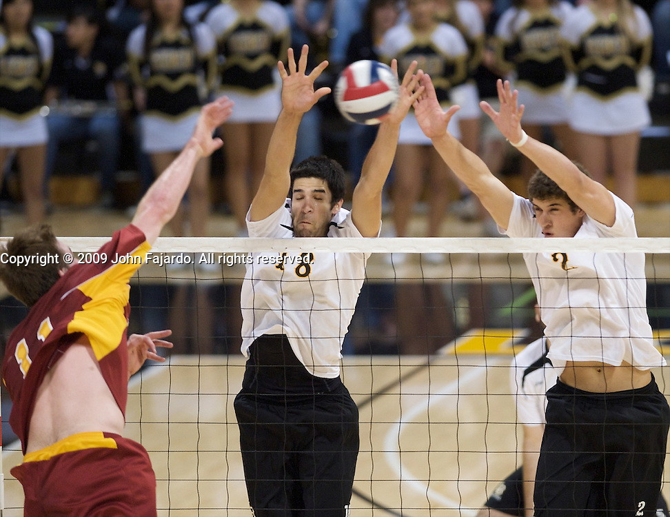 Dean Bittner(18) and Jim Baughman(2) attempt to block the attack by Murphy Troy(11) in Mountain Pacific Sports Federation play against USC at the Walter Pyramid, Long Beach CA, Wednesday, March 4, 2009.  Long Beach State loses in five sets, 31-29, 24-30, 30-23, 23-30, 13-15.