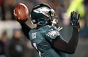 Philadelphia Eagles quarterback Michael Vick (7) throws a pass during pregame warmups before the NFL NFC Wild Card football game against the New Orleans Saints on Saturday, Jan. 4, 2014 in Philadelphia. The Saints won the game 26-24. ©Paul Anthony Spinelli
