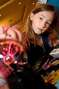 Kristen France, 9, a fourth grader at Morrison Elementary School in Athen examines an electricity ball at the Energy Fair at Ohio University on Tuesday, October 6, 2005.