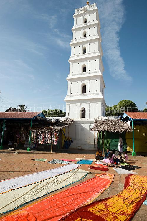 Minaret and courtyard of Dargah shrine. Sari's drying in the sun.