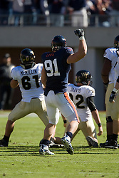 Virginia defensive end Chris Long (91) celebrates after a Wake Forest kicker Sam Swank (38) field goal attempt missed.  The #23 Virginia Cavaliers defeated the #24 Wake Forest Demon Deacons 17-16 at Scott Stadium in Charlottesville, VA on November 3, 2007.