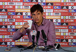 CARDIFF, WALES - Thursday, September 28, 2017: Wales' manager Chris Coleman drinks a cup of coffee during a press conference at the Vale Resort to announce his squad for the forthcoming 2018 FIFA World Cup Qualifying Group D games against Georgia and Republic of Ireland. (Pic by David Rawcliffe/Propaganda)