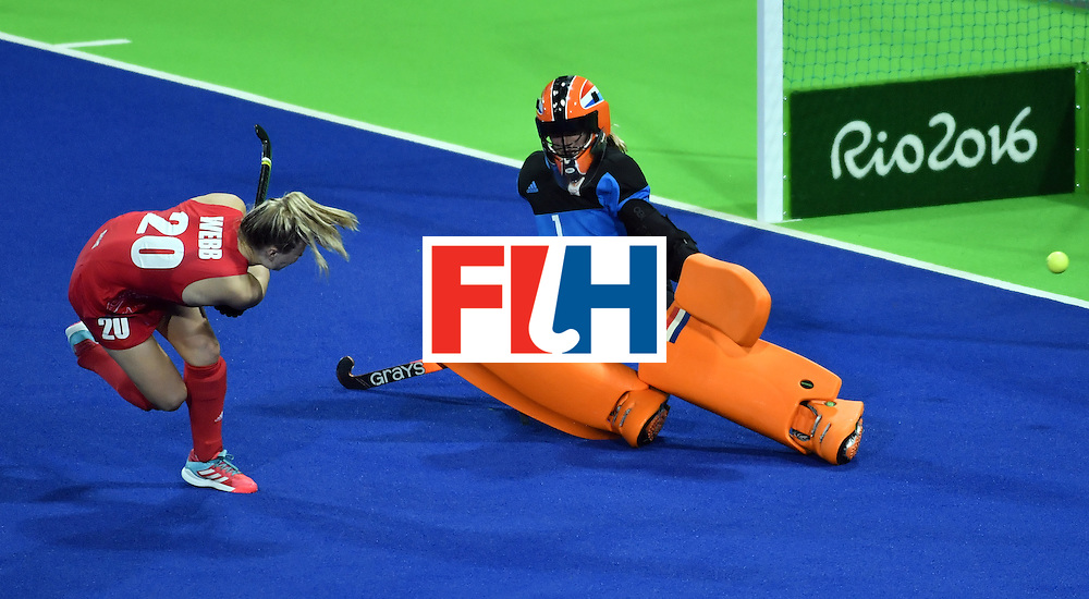 Britain's Hollie Webb (L) scores a goal during the penalty shoot-out at the end of the women's Gold medal hockey Netherlands vs Britain match of the Rio 2016 Olympics Games at the Olympic Hockey Centre in Rio de Janeiro on August 19, 2016. / AFP / Pascal GUYOT        (Photo credit should read PASCAL GUYOT/AFP/Getty Images)
