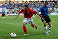 Photo: Paul Thomas.<br /> Estonia v England. UEFA European Championships Qualifying, Group E. 06/06/2007.<br /> <br /> Michael Owen (L) battles with Joel Lindpere.