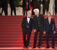 Iggy Pop and Director Jim Jarmusch with Festival Director Thierry Fremaux at the gala screening for the film Gimme Danger at the 69th Cannes Film Festival, Thursday 19th May 2016, Cannes, France. Photography: Doreen Kennedy