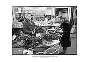 Two holly dealers on Moore Street, Dublin preparing wreaths for sale.<br />