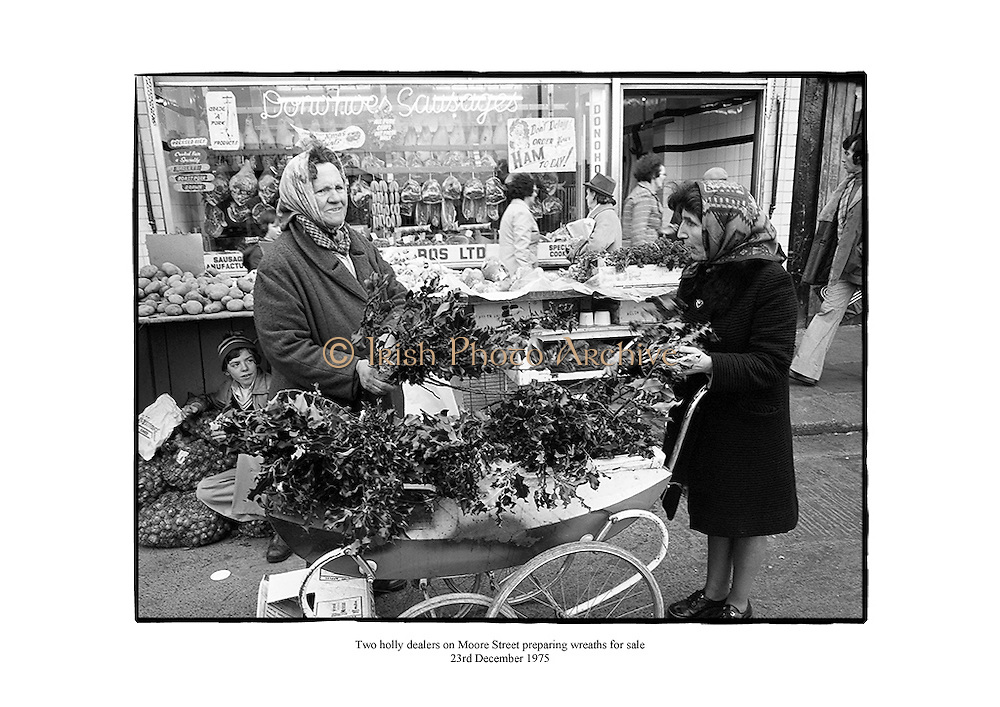 Two holly dealers on Moore Street, Dublin preparing wreaths for sale.<br /> <br /> 23/12/1975<br /> <br /> 23rd December 1975