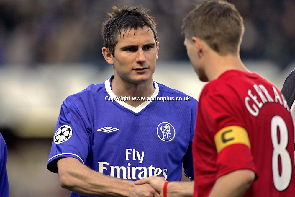 27 April 2005: Chelsea midfielder Frank Lampard shakes hands with Steven Gerrard before the first leg of the UEFA Champions League Semi-Final game between Chelsea and Liverpool. The game, played at Stamford Bridge ended 0-0. Photo: Glyn Kirk/Action plus<br /> <br /> london 050427 football soccer shaking