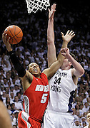 New Mexico guard Dairese Gary (5) attempts to score past BYU forward Noah Hartsock (34) during the second half of an NCAA college basketball game in Provo, Utah, Wednesday, March. 2, 2011. New Mexico defeated third-ranked BYU, 82-64. (AP Photo/Colin E Braley)
