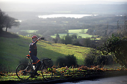 &copy; Licensed to London News Pictures.26/12/2017.<br /> Ide Hill, UK.<br /> Boxing day cyclist takes a selfie phone break at the top of  Ide Hill near Sundridge over looking Bough Beech Reservoir, Kent.<br /> Photo credit: Grant Falvey/LNP