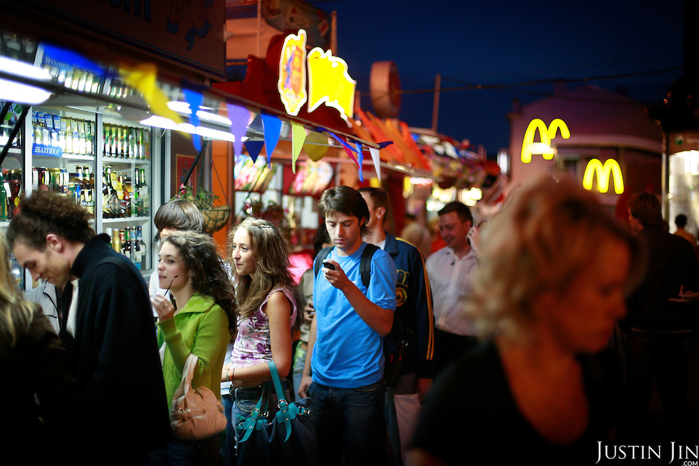 Pedestrians queue up for fast food at the Pushkin Square (Pushkinskaya Plochad) in the heart of Moscow on a fine summer's night. .The square is marked for a major revamp that will irk those who accuse the government of tearing down historic parts of the Russian capital. .Pushkin is one of Russia's most important writer.