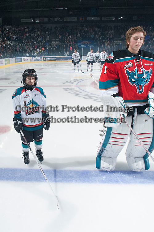 KELOWNA, CANADA - NOVEMBER 9:  The Pepsi Save-On Foods player of the game lines up on the ice beside Jackson Whistle #1 of the Kelowna Rockets as the Red Deer Rebels  visit the Kelowna Rockets on November 9, 2012 at Prospera Place in Kelowna, British Columbia, Canada (Photo by Marissa Baecker/Shoot the Breeze) *** Local Caption ***