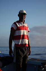 MAURITIUS BLACK RIVER 2MAY13 - Artisanal fisherman Herve Colfire works in his boat in Black Rivery Bay, Mauritius.<br /> <br /> <br /> <br /> Coastal fishing is in decline due to large, industrial foreign fishing fleets operating in Mauritian waters.<br /> <br /> The Greenpeace ship Esperanza is on patrol in the Indian Ocean documenting fishing activties.<br /> <br /> <br /> <br /> jre/Photo by Jiri Rezac / Greenpeace