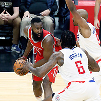 28 February 2018: LA Clippers center DeAndre Jordan (6) and LA Clippers guard C.J. Williams (9) defend on Houston Rockets guard James Harden (13) during the Houston Rockets 105-92 victory over the LA Clippers, at the Staples Center, Los Angeles, California, USA.